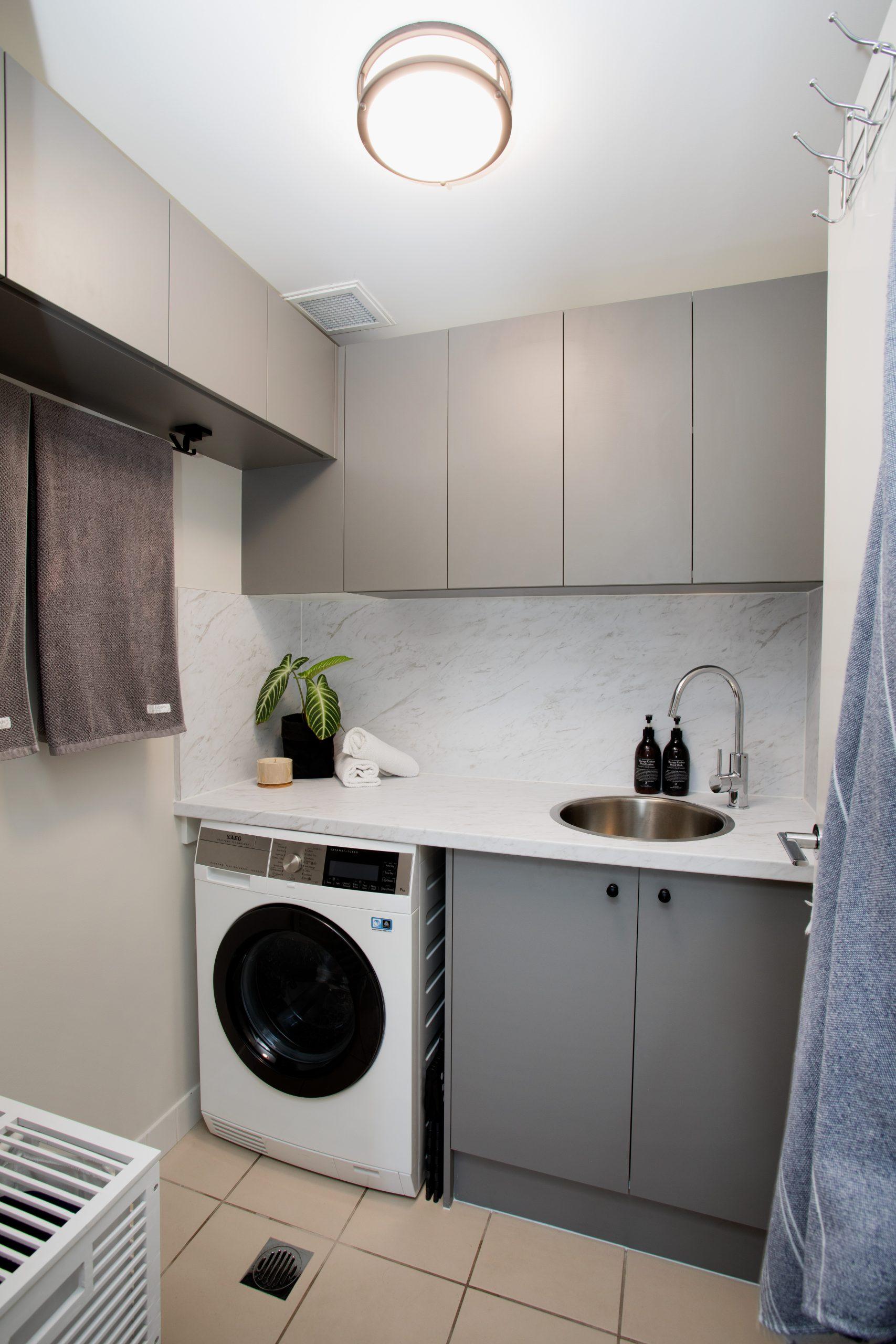 https://www.ivyandfinch.com.au/wp-content/uploads/2021/02/Roma-Street-Parklands-Interior-Design-Laundry-Renovation-scaled.jpg